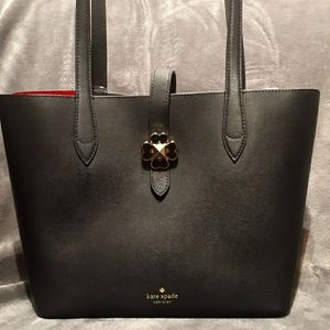Kate Spade tote with cute flower clasp.